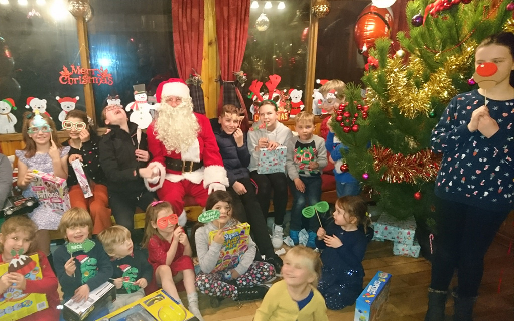 Local children enjoy Christmas party with support of local fish farm